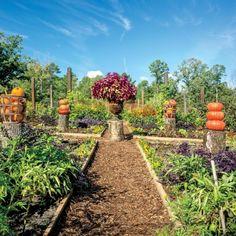 Tip from P. Allen Smith's Secret Veggie Garden: Treat pumpkins as sculptures and stumps as pedestals.