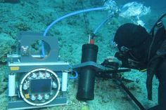 Researchers at Scripps Institution of Oceanography in California have developed an underwater microscope that's changing how scientists observe damaged coral as it fights for its life against algae blooms.