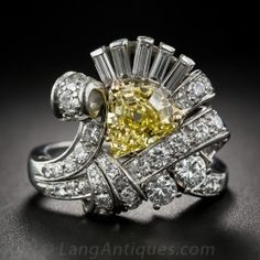 1.53 Carat Intense Fancy Yellow, Platinum and Diamond Vintage Cocktail Ring