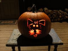 Adorable dog carved into a pumpkin. And it looks like my dog.