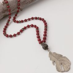 Bronze feather necklace by mygiraffedesigns on Etsy https://www.etsy.com/listing/244533743/bronze-feather-necklace