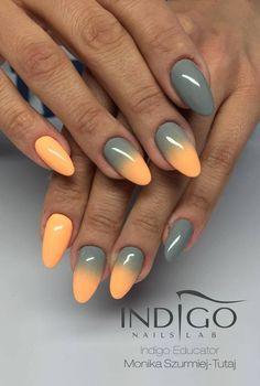 Stawiaj na zupełnie nowe kolory! Coraz częściej decydujemy się na zupełnie nowe kolory i połączenia barw lakieru na paznokciach. Dzięki temu możemy zyskać zupełnie inny styl i wygląd. Zaprezentowane na zdjęciu połączenie szarości i żywej pomarańczy sprawia wrażenie czegoś ekstrawaganckiego mimo swej prostoty. Warto pomyśleć o wizycie u kosmetyczki z planem takiego połączenia na najbliższe kilka dni. #manicure #paznokcie ##lakier ##do ##paznokci