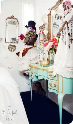 Love the teal dresser and glass bottle vase
