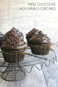 Triple Chocolate Jack Daniel's Cupcakes are totally to die for! Dark chocolate cupcakes with whiskey ganache and rich buttercream are a boozy dessert done right!