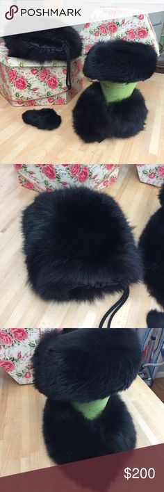 "Vintage Genuine Black Fox Accessories Gorgeous fox fur accessories that had been gifts to my magical godmother, Jackie, from her husband in the 1960's.  This set includes:  A muff that measures 9"" x 10"",  a pillbox-style hat with black satin that fits 21,"" a headband-style hat (with velcro) 24"" that is shown here as a collar & a small scrunchie-style band that would be worn around a ballerina bun back-in-the-day. I love these vintage treasures, but the hat is too small for me! I will not…"