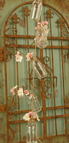 Decor: Tie string around milk bottles/small vases and hang with flowers in the bottles