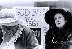 June 6, 1968: A supporter of Senator Robert Kennedy weeps openly as she awaits the arrival of the hearse bearing his casket to Air Force Two, at Los Angeles Airport.