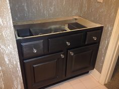 Custom metallic, glass bead and glitter finish on walls and black metallic finish on cabinet by Karla Boddie of Luxe Faux