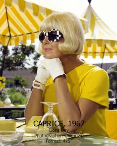 Doris Day from the film Caprice, 1967, with giant mod suglasses. This yellow and black and white outfit was surely part of the basis for 2003's memorable-yet-underappreciated, Doris & Rock-inspired film, Down With Love