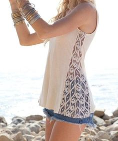 DIY turning a tight tank top into a loose fitting shirt by adding lace to the sides by tulasi.fanelli