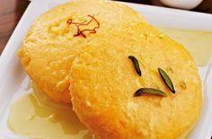 Raspuri rasmalai 8 slices bread, crust removed 200g : ripe mango, cubed 100g : condensed milk 250ml : milk pinch saffron 1 tsp : almond paste 2 drops rose water