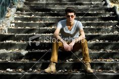 Young handsome man with modern hairstyle in stairs Royalty Free Stock Photo