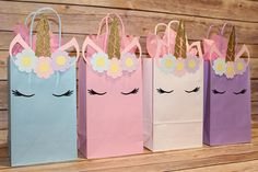 Who said unicorns aren't real?! Send the kiddos home with their goodies with these adorable Unicorn Party Favor Bags! (Message me the colors and quantity you would like. Otherwise, you will get: 2 Pinks, 2 Whites, 1 Blue and 1 Purple) QUANTITY: 6 - Unicorn Party Favor Bags.