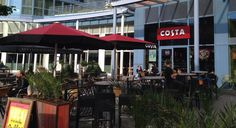 Costa Coffee Portsmouth Gunwharf Quays - Giant Umbrellas - Here at Shades of Comfort we specialise in outdoor furniture for companies, including giant umbrellas, terrace screens and much more. Costa Coffee, Look After Yourself, Portsmouth, Umbrellas, Terrace, That Look, Outdoor Decor, Commercial, News