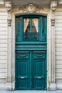teal green french door in stone home front, teal blue, jade, pantone shaded spruce