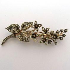 bcb2d0c3fa49 Broche en or rose branche de fleurs ornés de diamants. 1200 euros TTC