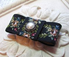 Hair clip Floral Tapestry Bow. Shades of black pink, blue, green. on Etsy