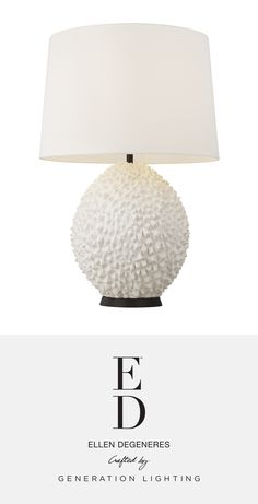 """ED Ellen DeGeneres   The Anhdao Table Lamp channels the natural beauty and texture of the exotic durian fruit, adoringly designated in Southeast Asia as the """"king of fruits"""". An instant conversation starter, Anhdao's milky Matte White resin base is paired with a neutral, perfectly-tailored White Linen shade. Metal accents are available in two finish options: the more rustic Aged Iron or classic Burnished Brass. Available at clarksonlighting.com Ed Ellen Degeneres, Metal Accents, Light Table, Lamp Design, Table Lamps, Southeast Asia, Natural Beauty, Conversation, Exotic"""