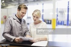 Stock Photo : Mechanic talking to customer in garage
