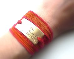 They are like a vibrant silk sari for your arm and can fit any size wrist. Enjoy a beautiful mantra handstamped on a chic brass tag with your choice of silk.