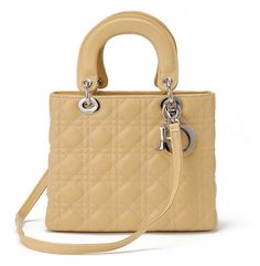 The medium Lady Dior bag in beige lambskin with light gold hardware