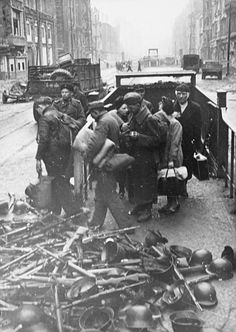 Prisoners. ... WW2. German soldiers coming out of the tunnel of the Berlin underground and surrendering. May. Berlin 1945