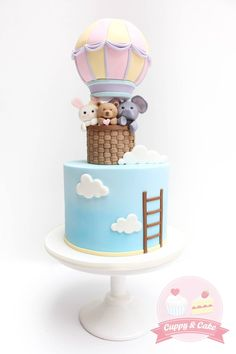 Cuppy & Cake - Hot air balloon themed cake, with cute little toys!