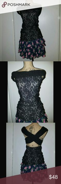 Gorgeous Lace Top NWOT!!! Victoria's Secret Lace Top in Large  Lovely black lace with nude lining underneath, giving a drop neckline in the front and an amazing criss cross open alluring back, which also drops low. You can wear this on your shoulders or off. So unique and sexy! Must-have! Can fit a large or medium. It does have great stretch. Pair with one of my lace skirts and ankle boots for a fun day look. Or dry with denim and any of my killer boots for a more daring look!!  Nwot. Brand…