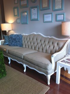 we have just added a new item to our rental arsenal...this gorgeous vintage sofa, reupholstered in linen and laqcuered white! isn't she a be...