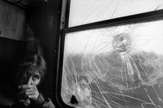 by Paolo Pellegrin, A Gypsy woman in the train, Kosovo, 2001