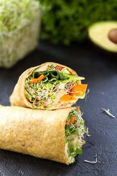 flax wrap with hummus, veggies, and sprouts