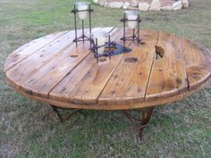 Coffee table made from repurposed cable spool and metal base. #cablespool #woodreel #cablereel #woodspool #woodenspool #coffeetable