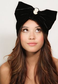 Velvet Bow Black Cameo Headband Turban Ear warmer Headpiece. $32.00, via Etsy.
