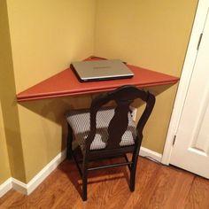Corner computer desk-- good use of space.