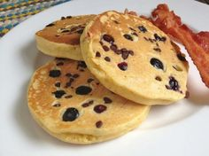Light, crisp, and fluffy gluten-free multigrain pancakes with chocolate chips and blueberries make for a rich and satisfying breakfast.