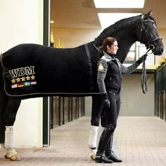 Love the all black styled horse and rider - and the patent leather dressage boots. Very stylish for every day schooling.
