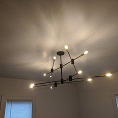Karl 12 - Light Sputnik Modern Linear Chandelier & Reviews | AllModern Edison Bulb Chandelier, Linear Chandelier, Black Chandelier, Chandelier Lighting, Ceiling Lamp, Ceiling Lights, Beautiful Lights, Modern Lighting, All Modern