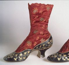 Boots  Date	1883  Description	 Boots, high-button style, of dark red silk satin brocade with black kidskin vamp, quarter, and baby French heel. Kidskin is decorated with cut-out pattern of rhododendron leaves underlaid with gold-colored kid. Scallop-edge closure along side with circular brass buttons.  Costume and Textile Collection, Chicago History Museum