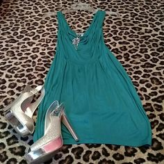 Hot Miami Styles Dress A teal colored dress purchased from Hot Miami Styles a couple years ago. It never fit quite the way I had hoped. It's got a cowl neck front and ruching/puckered back. Recently reduced!! WOW couture Dresses