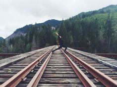 Erin from The Bar Method Portland is shown here doing a runner's lunge at Vance Creek Bridge. What a gorgeous shot! #WhereDoYouBar?