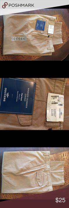 NWT Dockers Men's slacks 34X30 NWT Mens slacks. Classic Fit, Flat Front. Bought these for my husband but don't fit. Dockers Pants Chinos & Khakis