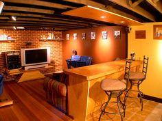 basement man cave with hardwood flooring