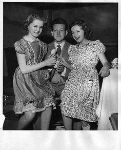 Donald O'Connor, 1951. He topped the bill at the Palladium in London. Pictured backstage at a tea party with two young girls from the cast