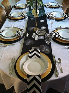 Not so much the gold, but love the black  chevron napkins.  maybe mix with red for a christmas tablescape inspiration.