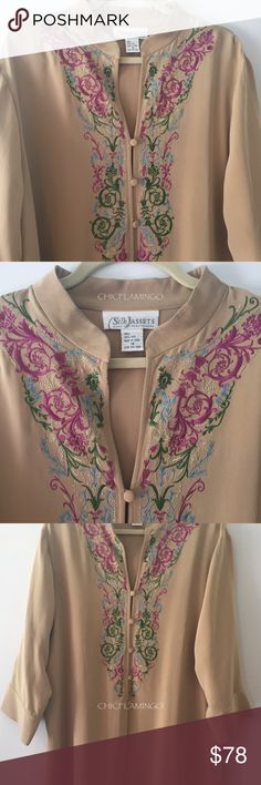 DVF vintage embroidered 100% silk tunic plus sz 1X Diane Von Furstenberg Silk Assets tunic 📷 Watermarked photos are item you will receive.   Diane von Furstenberg is a Belgian-American fashion designer.  Her fashion company is a global luxury lifestyle brand worn by many celebrities: Gwyneth Paltrow, Madonna, Jessica Alba, and Susan Sarandon.    * 100% silk. * Exquisite embroidery detailing.  * Front button closure to waist.  * Three-quarter sleeves. * Vintage. * Vented 11 inch sides…
