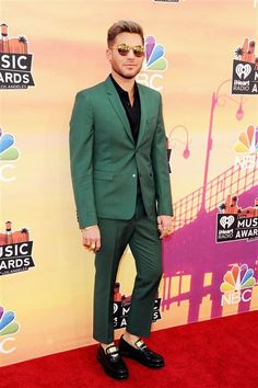 Adam Lambert attends the 2014 iHeartRadio Music Awards held at The Shrine Auditorium in Los Angeles on May 1, 2014.Like us on Facebook?