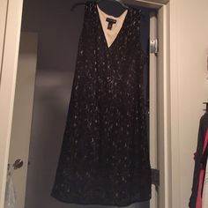 Black lace dress over tan underlay Worn once. Great for parties. No wear or tears. Size 20. Side zip. I'm 5'2 and comes to right below my knee. Lane Bryant Dresses Midi