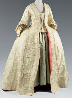 Manteau de robe à la francaise, England, c. 1760. Straw yellow silk damask, self fabric trimming.