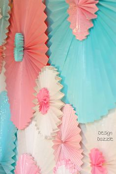 DIY: paper rosettes made with paper window shades. Super Easy!