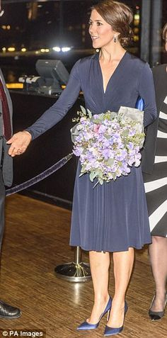 feb 2016--The elegant royal, known for her economic approach to fashion, recycled the dark blue Issa dress she wore during an official event on 4 February for World Cancer Day